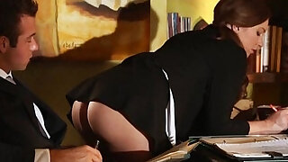 Sexy secretary fucked on the table