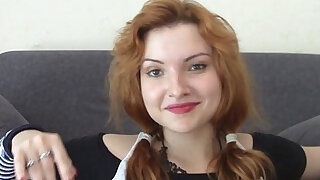 Horny redhead masturbating on the couch