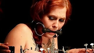 Gagged redhead teen brunette babe in bondage device gets spanked
