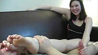 Cute Girl gives hand job while her boy friend licks her feet